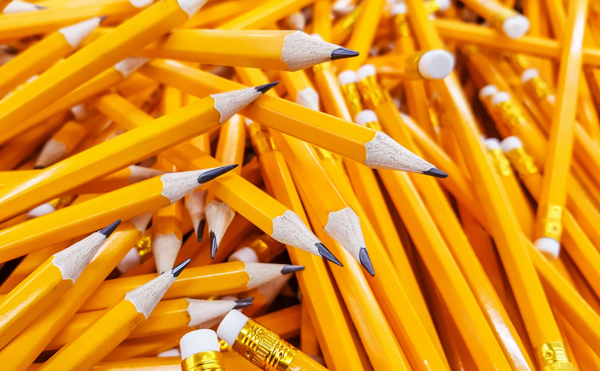Many pencils piled in a big pile